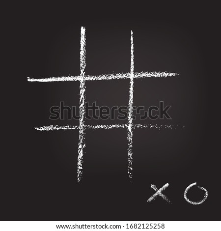 Empty cross zero game template hand drawn on dark blackboard. XO handwritten sign on low corner. Tic-tac-toe competition. Chalk graffiti on board design. Entertainment and recreation. Grunge design Foto stock ©