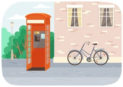 Empty London red classic telephone booth with an open door on the street with a bicycle at the building. City summer landscape with public telephone and brick wall with windows, Empty urban street