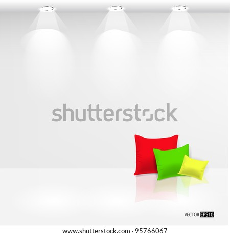 Empty wall with spot lights and pillows on white floor