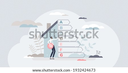 Energy efficient house with resources consumption classification tiny person concept. Home environmental rating diagram as green and ecological heating or electricity performance vector illustration. Foto stock ©