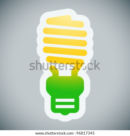 Energy saving light bulb on grey background
