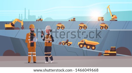 engineers using radio and tablet workers controlling professional equipment. working on coal mine extraction industry, mining transport concept, opencast stone quarry background flat horizontal.