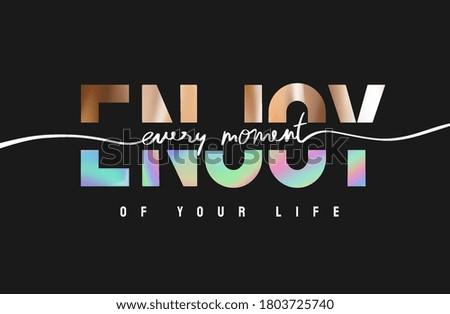 enjoy moment slogan rainbow and gold foil print on black background Foto stock ©