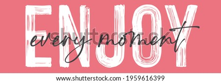 enjoy slogan print. text print for t-shirt, sticker, apparel, wallpaper, background and all uses Foto stock ©