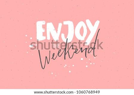 Enjoy the weekend. Inspirational caption, handwritten text on pastel pink background.
