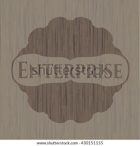 Enterprise badge with wooden background