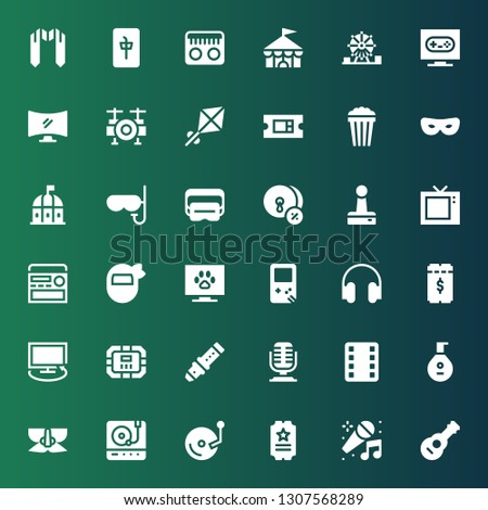 entertainment icon set. Collection of 36 filled entertainment icons included Guitar, Karaoke, Ticket, Vinyl, Turntable, Mask, Lute, Film, Microphone, Flute, Poker table, Tv, Headphones #1307568289