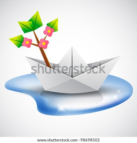 environment protection concept - save nature - paper ship with green leaves blossom tree  branch