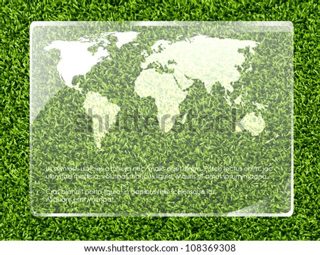 environmental technologies. Map of the World on a glass surface with grass
