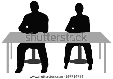 EPS10 Vector. Two business people sitting a desk.