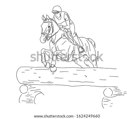 Equestrian eventing. A rider on a horse jumps over a lying tree.