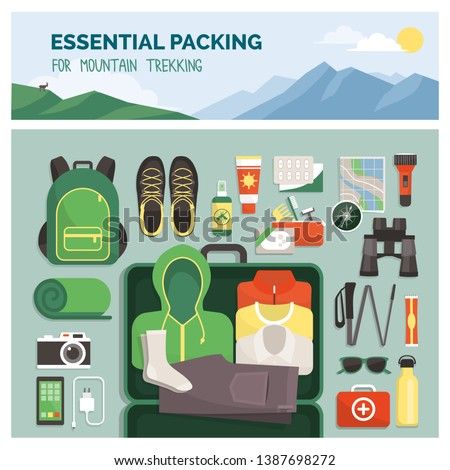 Essential packing for mountain trekking, outdoor travel and sport, clothes and accessories top view