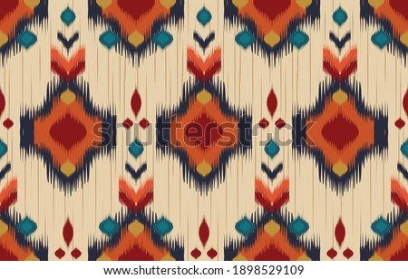 Ethnic abstract background. Seamless in tribal, folk embroidery, native ikat fabric. Aztec geometric art ornament print. Design for carpet, wallpaper, clothing, wrapping, textile, tissue, decorative