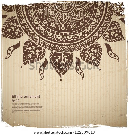 Ethnic sun ornament on the Cardboard background