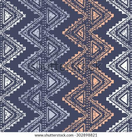 Ethnic vintage ornament. Vertical stripes. Zigzag. Old background. Handmade. Blue, white and beige color.