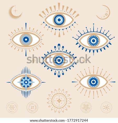 Evil eye vector design elements. Magic, witchcraft, occult symbol, bohemian. line art collection. Hamsa eye, magical eye, decor element. Blue, white, golden eyes.