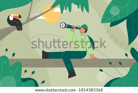 Explorers, travelers in the jungle large green leaves. Man Looks at the Toucan bird through binoculars. Concept of discovery, exploration, hiking, adventure tourism and travel.