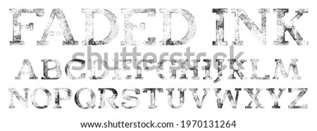 Faded ink stamped font. Slab Serif Display Font, works well at large sizes. Highly detailed hand textured characters with a faded, rolled ink print texture. Foto stock ©