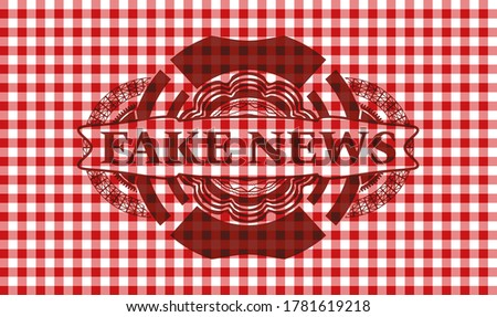 fake news text inside red