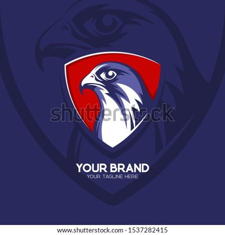 falcon head logo badge in blue