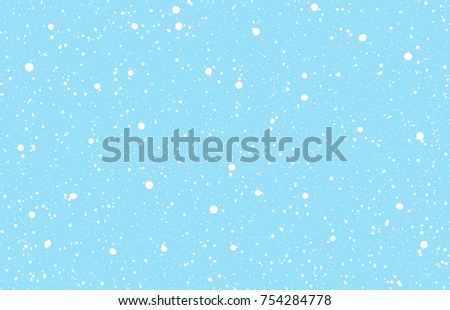 falling snow on a light blue