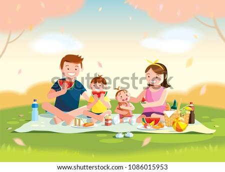 family enjoying picnic they