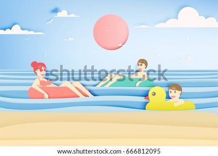 family floating on the beach