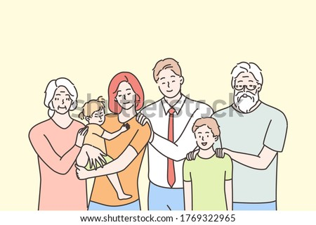 Family, portrait, motherhood, fatherhood, childhood, love concept. Happy father mother grandmother grandfather and children kids son daughter standing looking at camera. Three generations together.
