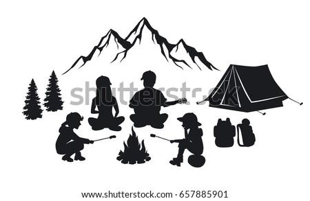 family sit around campfire...