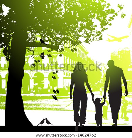 Family walk in the city park