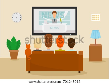 family with cat watching tv