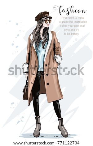 Fashion model posing. Stylish beautiful woman in coat and cap. Hand drawn fashion woman. Sketch. Vector illustration.
