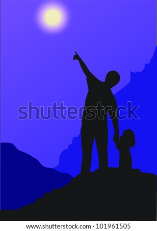 Father and daughter looking at the night sky