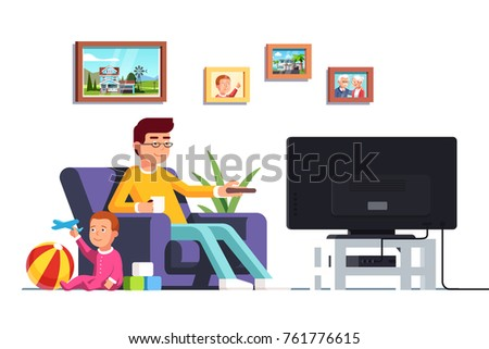 father sitting on armchair