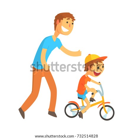 Father teaching his son to ride a bicycle