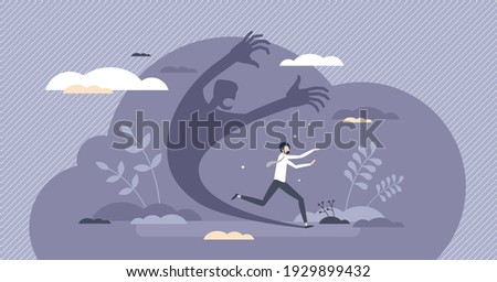 Fear attack as businessman afraid from its own shadow tiny person concept. Threaten and terrify feeling from insecurity and doubt vector illustration. Inner conflict and phobia as negative emotions. Foto stock ©