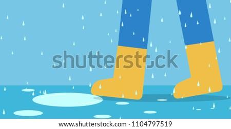 feet of man in rain boots walk
