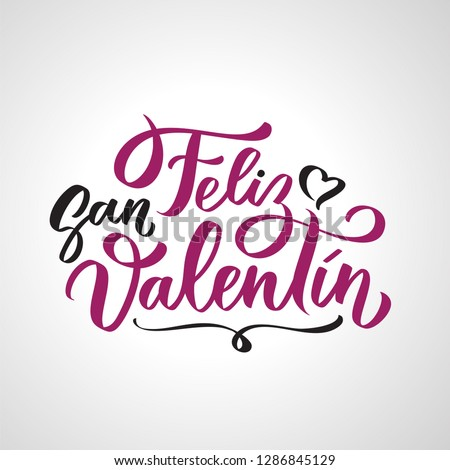 Feliz San Valentin handwritten lettering on Spanish on Valentines day. Black calligraphic text, typography in two colors isolated on white background. #1286845129