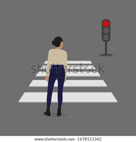 Female character stands in front of a pedestrian crossing and a traffic light with a red signal
