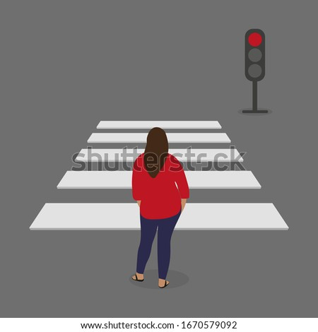 Female character stands in front of a pedestrian crossing and traffic light with red light
