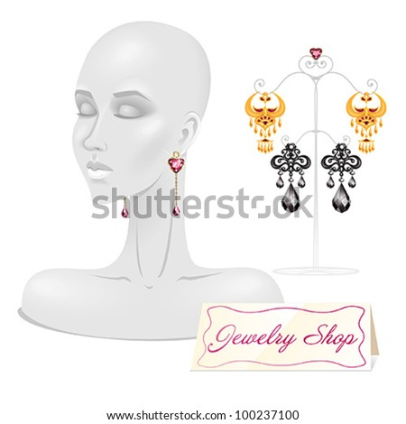 Female Face Mannequin with 3 sets of beautiful earrings - stock vector