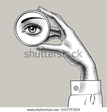 Female hand holding in fingers a round small mirror with a reflection of her eye. Vintage engraving stylized drawing. Vector illustration