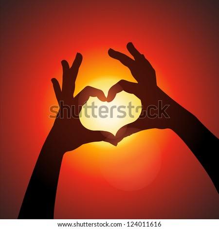 female hands making sign heart
