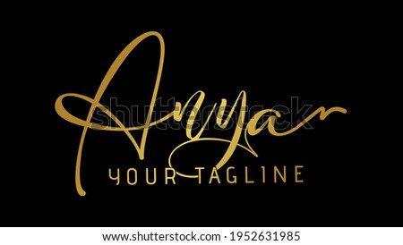 Female name Anya in Stylish and creative handwritten gold and golden name, isolated on black background. Stock fotó ©