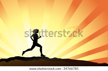 Female runner silhouette with sunset sky as backdrop