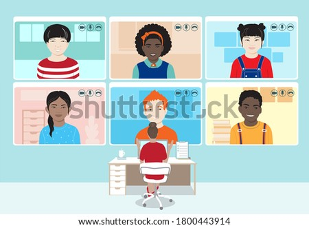 Female teacher at the workplace with laptop, students screens, remote lesson for young school children using video conference app. Distance school, online education safety during coronavirus pandemic.