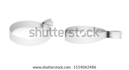 Festival party fabric wristbands with black plastic lock isolated on white background. Identity cloth bracelets. Vector mockup with blank access control design for music concert, dance and events Foto stock ©