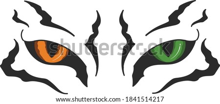Fierce tiger eyes with different eye color and wild pattern Stock photo ©
