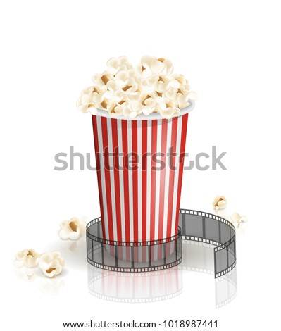 Filmstrip rolled around the full white-and-red striped bucket of popcorn. Vector illustration. Object isolated on the white background. Popcorn fallen from a bucket. Cinema snack and movie food.