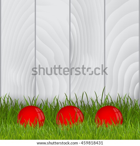 find three red balls on grass